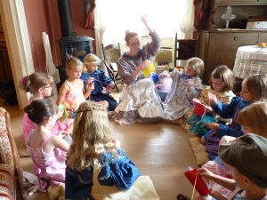Jill leading a birthday party, one of the many programs she has developed for the Oshawa Museum